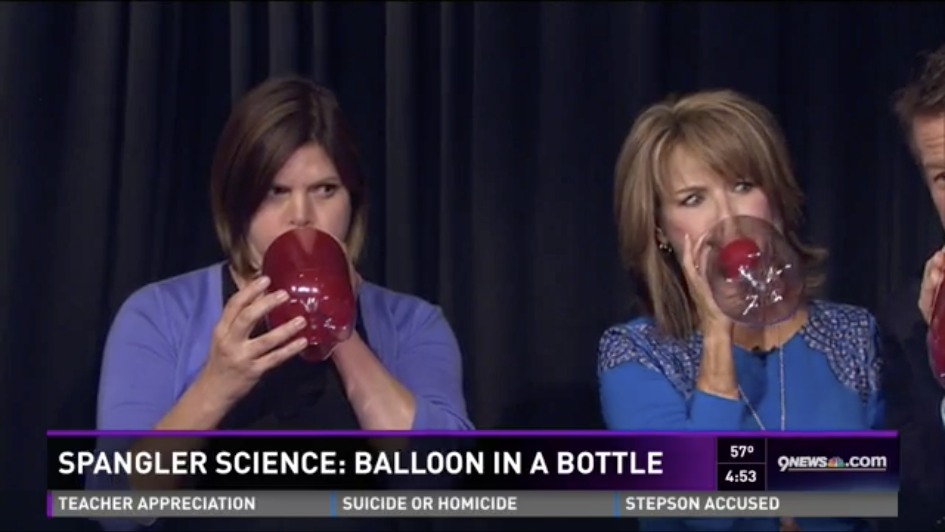 Steve Spangler and Kim Christiansen Blowing up balloons on 9News